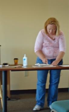 Nancy McDougle and book repair